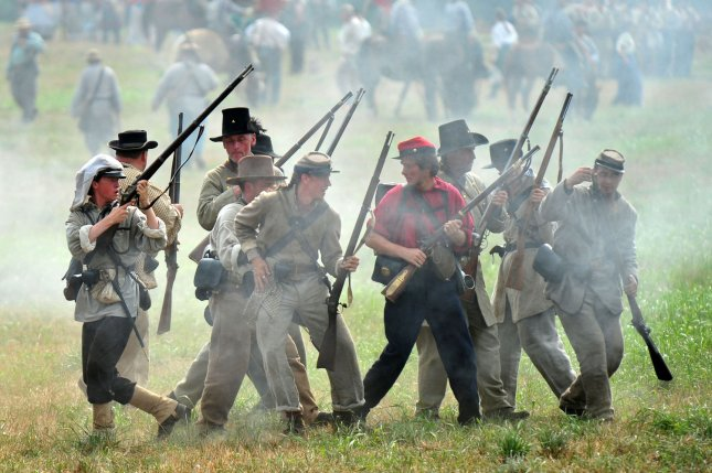 Confederate troops fall back during the reenactment of the Battle of Bull Run at Brawner Farm in Manassas, Virginia on July 24, 2011. This event marked the 150th anniversary of the the first major battle of the Civil War. UPI/Kevin Dietsch