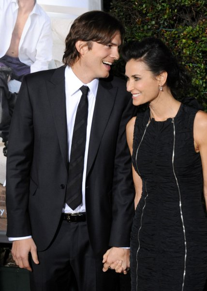 Actor Ashton Kutcher, a cast member in the motion picture romantic comedy No Strings Attached and his wife, actress Demi Moore attend the premiere of the film at the Regency Village Theatre in the Westwood section of Los Angeles on January 11, 2011. UPI/Jim Ruymen
