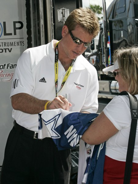Hall of Fame quarterback Troy Aikman signs autographs in the garage area prior to the 50th annual NASCAR Daytona 500 at Daytona International Speedway in Daytona Beach, Florida on February 17, 2008. (UPI Photo/Chad Cameron)