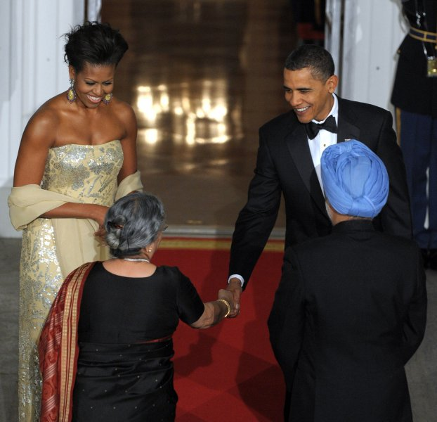 U.S. President Barack Obama and first lady Michelle Obama welcome Indian Prime Minister Manmohan Singh and his wife Gursharan Kaur on the North Portico of the White House for a State Dinner, Nov. 24, 2009. This is President Obama's first state dinner. UPI/Roger L. Wollenberg