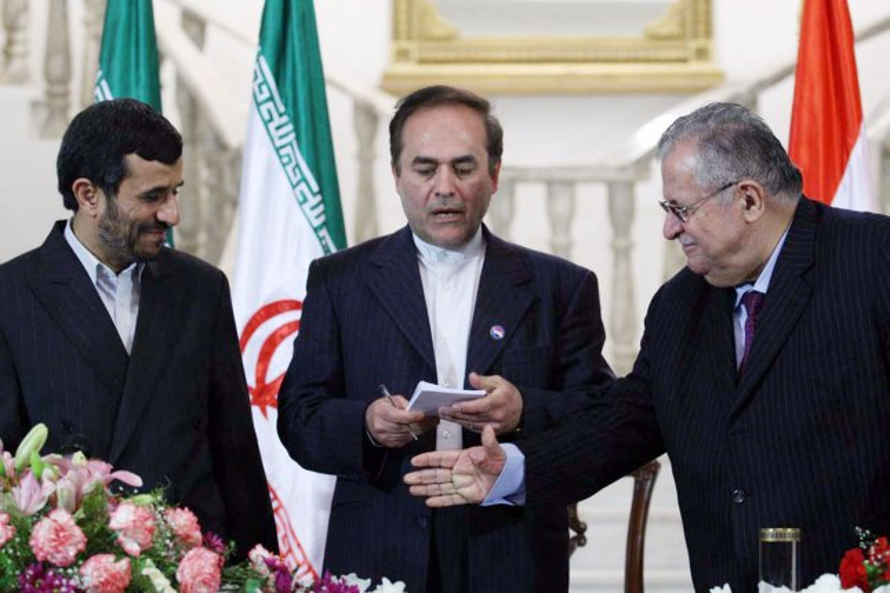Iraqi President Jalal Talabani (R) reaches for the hand of Iran's President Mahmoud Ahmadinejad (L) during their meeting in Baghdad, Iraq on March 2, 2008. (UPI Photo/Hossein Salmanzadeh/Fars News Agency)