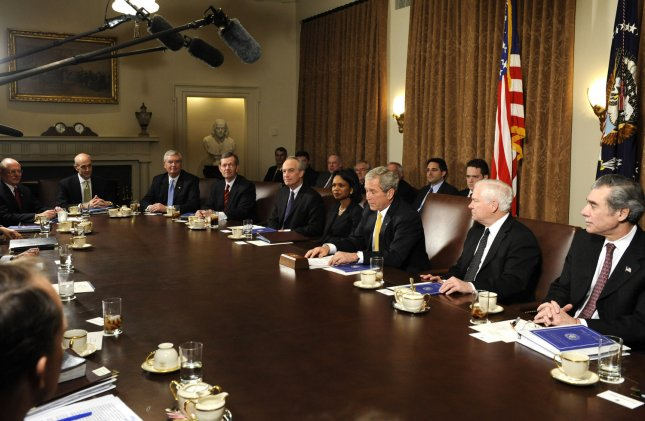 President George W. Bush (3rd-R) delivers remarks to the media following a meeting with his Cabinet, in the Cabinet Room at the White House in Washington on January 13, 2009. Bush was joined by, from left to right, Veterans Affairs Secretary James Peake, Homeland Security Secretary Michael Chertoff, EPA Administrator Stephen Johnson, Health and Human Services Secretary Michael Leavitt, Interior Secretary Dirk Kempthorne, Secretary of State Condoleezza Rice, Defense Secretary Robert Gates and Commerce Secretary Carlos Gutierrez. (UPI Photo/Kevin Dietsch)