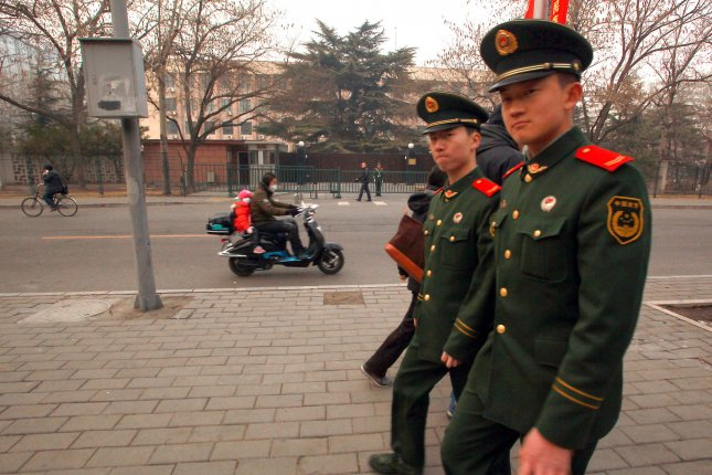 Chinese soldiers walk past the North Korean Embassy in Beijing. In February, China rejected a North Korea request to join the Asian Infrastructure Investment Bank. File Photo by Stephen Shaver/UPI