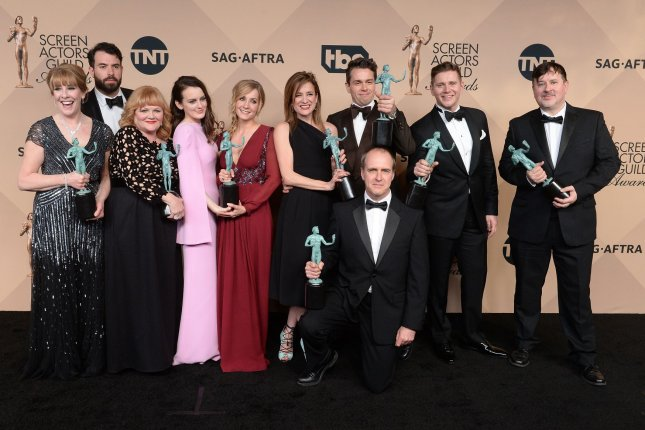 From left, actors Phyllis Logan, Tom Cullen, Lesley Nicol, Sophie McShera, Joanne Froggatt, Raquel Cassidy, Kevin Doyle, Julian Ovenden, Allen Leech and Jeremy Swift, winners of Outstanding Performance by an Ensemble in a Drama Series for Downton Abbey, appear backstage during the 22nd annual Screen Actors Guild Awards at the Shrine Auditorium & Expo Hall in Los Angeles on January 30, 2016. Photo by Jim Ruymen/UPI