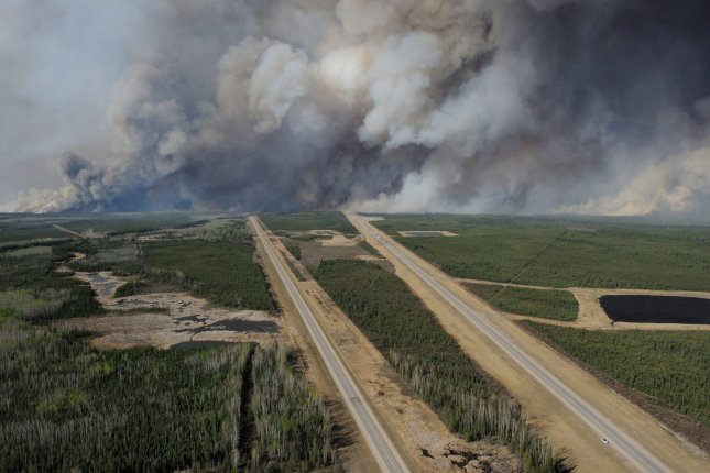 Aerial view of Fort McMurray taken from a CH-146 Griffon helicopter on Thursday. David Yurdiga, a member of the Canadian House of Commons, said about 20 percent of homes in the Canadian city have been destroyed in a wildfire that forced the evacuation of more than 100,000 people. Photo by MCpl VanPutten/Canadian Armed Forces/UPI