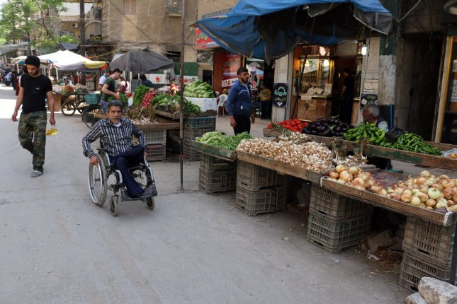 Vendors sell fruits and vegetables in eastern Aleppo, Syria, earlier this year. File Photo by Ameer Alhalbi/ UPI