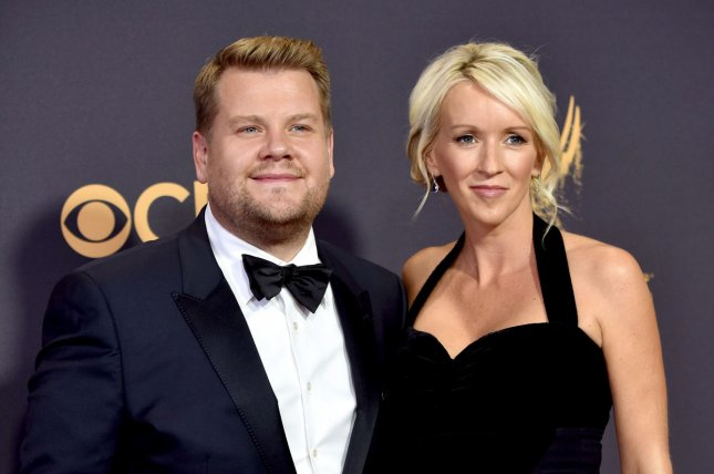 James Corden (L) and Julia Carey (R) arrive for the 69th annual Primetime Emmy Awards on September 17. Corden will be hosting the Hollywood Film Awards in November. File Photo by Christine Chew/UPI
