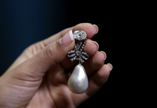 A pearl and diamond pendant owned by Queen of France Marie Antoinette sold for a record 36 million at a Sotheby's auction in Switzerland on Wednesday. Photo by John Angelillo/UPI
