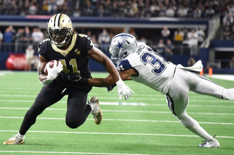 New Orleans Saints running back Alvin Kamara gets past Dallas Cowboys defender Byron Jones on a short catch during their NFL game on November 29 at AT&T Stadium in Arlington, Texas. Photo by Ian Halperin/UPI