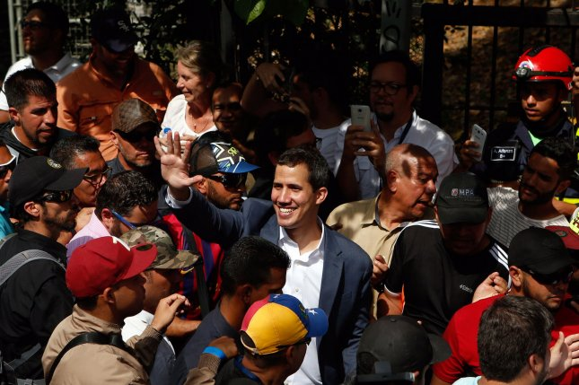 Opposition leader Juan Guaido waves at thousands of supporters during a gathering in Caracas on Saturday. Photo by Cristian Hernandez/UPI
