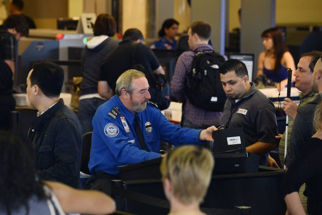 Computer systems are slowly coming back online at U.S. Customs and Border Patrol immigration checkpoints at airports. Photo byJim Ruymen/UPI