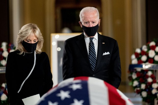 Democratic presidential nominee Joe Biden and Dr. Jill Biden stand in front of the casket of Supreme Court Associate Justice Ruth Bader Ginsburg as she lies in state at the U.S. Capitol in Washington, D.C., on September 25. Photo by Erin Schaff/UPI/Pool