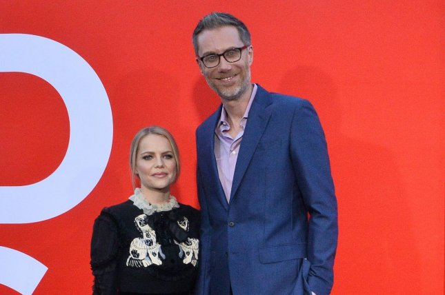 Stephen Merchant (R) -- seen here with model Mircea Monroe in 2019 -- is filming two seasons of his new show The Offenders back-to-back in the U.K. File Photo by Jim Ruymen/UPI