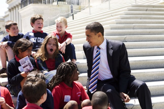 U.S. presidential hopeful Sen. Barack Obama, D-IL, stops to speak with school kids from Holy Cross as he departs after a vote on amendments to S.2284, the Flood Insurance Reform and Modernization Act of 2007, on Capitol Hill in Washington on May 13, 2008. (UPI Photo/Patrick D. McDermott)