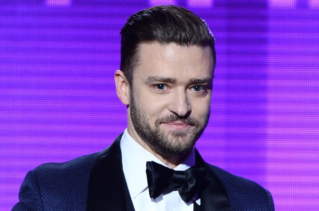 Recording artist Justin Timberlake accepts the Favorite Male Artist - Pop/Rock award onstage at the 41st annual American Music Awards held at Nokia Theatre L.A. Live in Los Angeles on November 24, 2013. UPI/Jim Ruymen