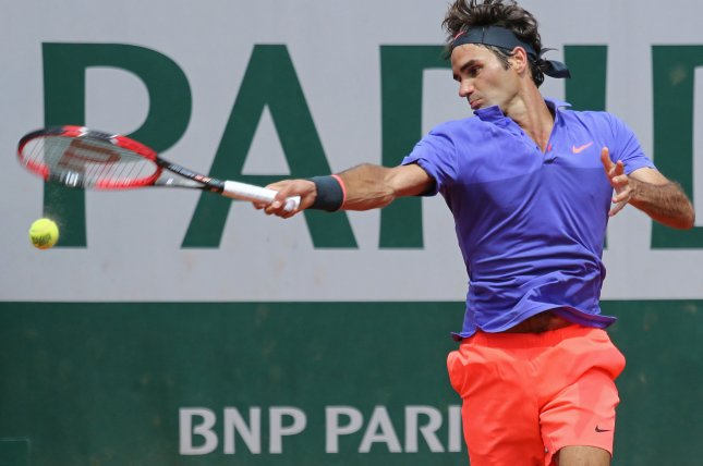 Roger Federer of Switzerland hits a shot during his French Open men's second round match against Marcel Granollers of Spain at Roland Garros in Paris on May 27, 2015. Federer defeated Granollers 6-2, 7-6 (1), 6-3 to advance to the next round. Photo by David Silpa/UPI