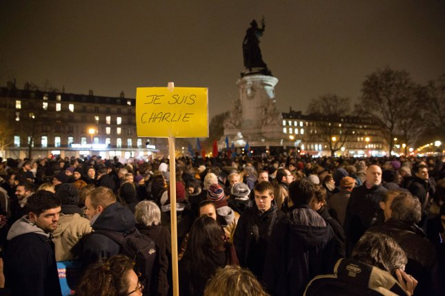 French people rally at one of Paris' main squares in a display of solidarity after the terrorist attack at Charlie Hebdo weekly newspaper in Paris on January 7, 2015. In France's deadliest postwar terrorist attack, 2 policemen and 10 journalists died after terrorists stormed and open fired during an editorial conference. File Photo by Eco Clement/UPI
