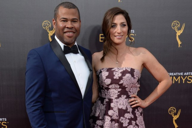 Get Out writer and director Jordan Peele (L) pictured with his wife Chelsea Peretti (R). Get Out landed the Best Picture award from the Online Film Critics Society. File Photo by Jim Ruymen/UPI