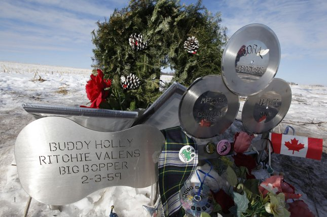 Flowers and tributes are left 50 years later at the site of the plane crash that killed Buddy Holly, Ritchie Valens and J. P. The Big Bopper Richardson near Clear Lake, Iowa, on February 2, 1959. File Photo by Brian Kersey/UPI