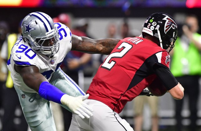 Dallas Cowboys defensive end Demarcus Lawrence sacks Atlanta Falcons quarterback Matt Ryan during a game in November. Photo by David Tulis/UPI