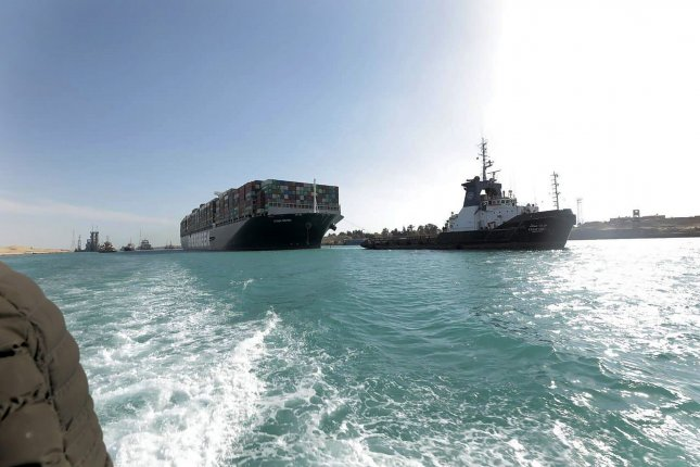 The Ever Given, a Panama-flagged cargo ship, is pulled by tugboats in Egypt's Suez Canal on Monday. The backlog of ships caused by the Ever Given's becoming lodged in the canal. Photo courtesy of the Suez Canal Authority Office