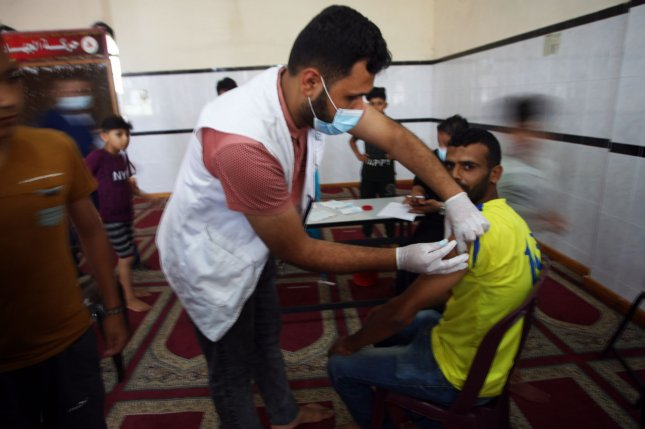 A Palestinian man receives a dose of Russia's Sputnik V COVID-19 vaccine in Saad Mosque in Rafah in Tal al-Sultan town in the southern Gaza Strip, on July 12. Photo by Ismael Mohamad/UPI