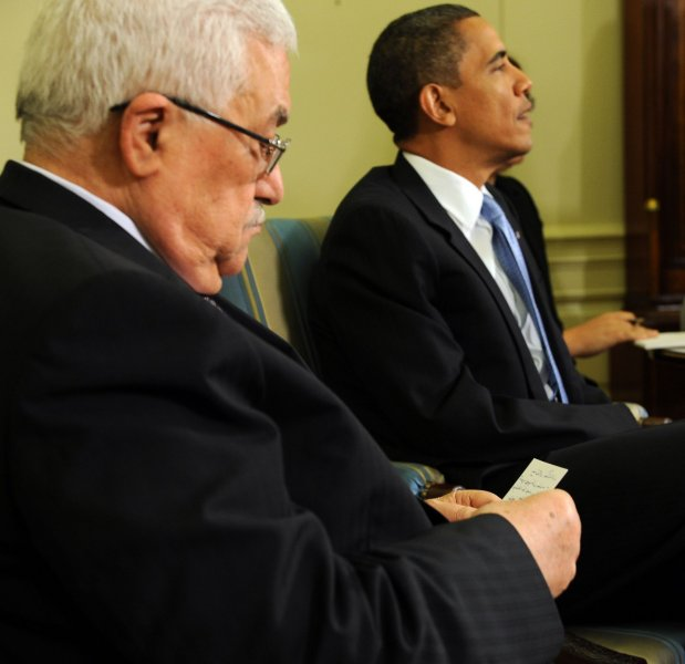 Palestinian President Mahmoud Abbas looks over notes before speaking to the media after meeting with U.S. President Barack Obama in the Oval Office of the White House in Washington on June 9, 2010. UPI/Roger L. Wollenberg