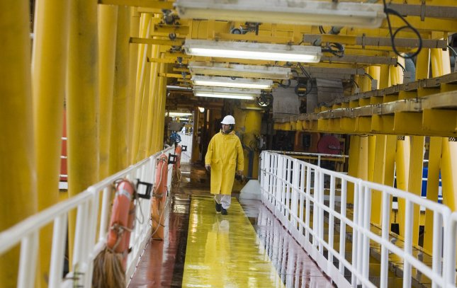 A Iranian worker walks on the South Pars quarter one (SPQ1) natural gas platform in the Persian gulf waters near the southern port of Asalouyeh, Iran, on January 27, 2011. South Pars is the world's largest gas field, and shared between Iran and Qatar. Iran expects to fully develop its part of South Pars by 2015. UPI/Maryam Rahmanian