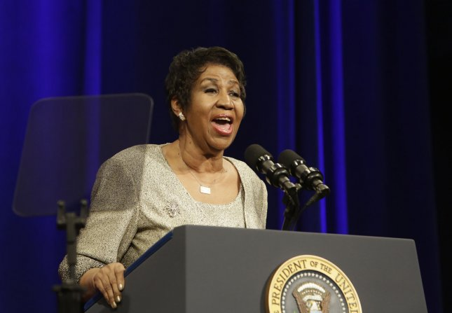 Aretha Franklin sings at the portrait unveiling ceremony for outgoing U.S. Attorney General Eric Holder at The Department of Justice in Washington, DC, February 27, 2015. Pool photo by Chris Kleponis/UPI