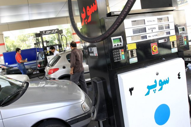 BP CEO Bob Dudley says Iran deserves careful review, but adds few investors are rushing through the door given constraints on available capital. Pictured, an Iranian man pumps gas into his car at a gas station in Tehran, Iran. File photo by Maryam Rahmanian/UPI