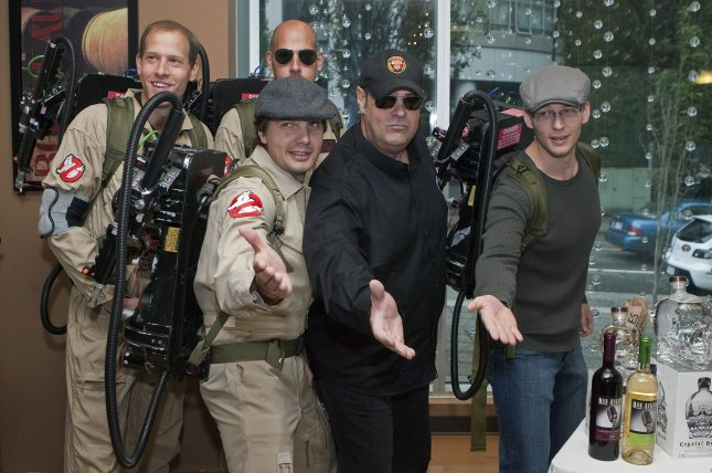 Dan Aykroyd (middle) poses with fans dressed as Ghostbusters on September 23, 2010. Aykroyd has once again commented on Ghostbusters reboot director Paul Feig and how plans for a sequel have been scrapped. File Photo by Heinz Ruckemann/UPI