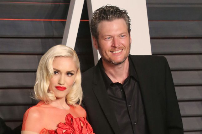 Blake Shelton (R), pictured here with Gwen Stefani, gives the singer a shoutout in his new song Turnin' Me On. File Photo by David Silpa/UPI