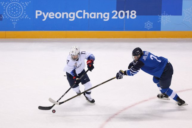 U.S. player Jocelyne Lamoureux-Davidson (L) and Mira Jalosuo of Finland fight for the puck during their women's ice hockey game at the Kwandong Hockey Center in Gangneung, South Korea, during the 2018 Pyeongchang Winter Olympics on Sunday. Photo by Andrew Wong/UPI