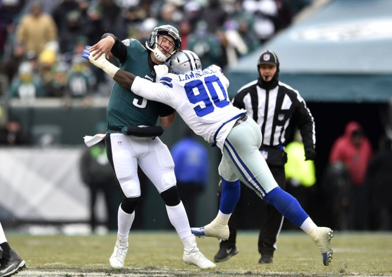 Dallas Cowboys defensive end DeMarcus Lawrence hits Philadelphia Eagles quarterback Nick Foles during a game in December. Photo by Derik Hamilton/UPI