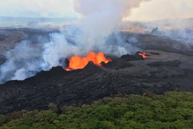 View released on Tuesday of spatter and splashing build ramparts around Fissure 22, in Kilauea Volcano's lower East Rift Zone. A moderate-level eruption of lava continues along the northeast end of the active fissure system. Photo by USGS/UPI