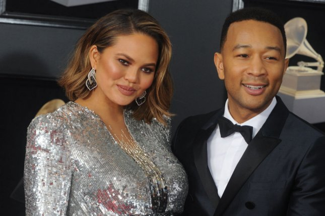 Chrissy Teigen (L), pictured with John Legend, shared a video and a body-positive message Monday on Twitter. File Photo by Dennis Van Tine/UPI