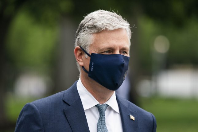 National security adviser Robert O'Brien is pictured walking to the White House in Washington, D.C., on May 24. The White House confirmed Monday that he's tested positive for COVID-19. File Photo by Jim Lo Scalzo/UPI