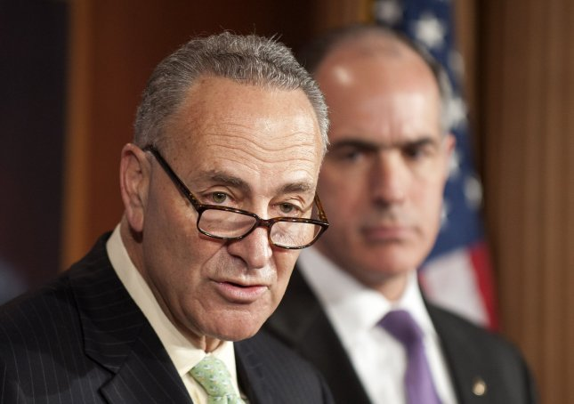 Sen. Chuck Schumer (D-NY) and Bob Casey (D-PA) announce the 'Ex-PATRIOT' (Expatriation Prevention by Abolishing Tax-Related Incentives for Offshore Tenancy) Act aimed at taxing expatriates even after they flee the United States and take up residence in a foreign country, on Capitol Hill in Washington on May 17, 2012. This legislation takes aim at Facebook co-founder Eduardo Saverin who recently renounced his U.S. citizenship days away from the Facebook IPO where he stands to make $4 billion. UPI/Kevin Dietsch