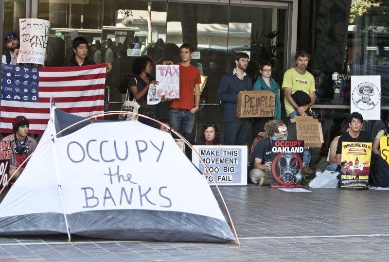 A group of protesters blocks the enterance to a Citi Bank branch in Oakland, California on November 3, 2011. File/UPI/Terry Schmitt