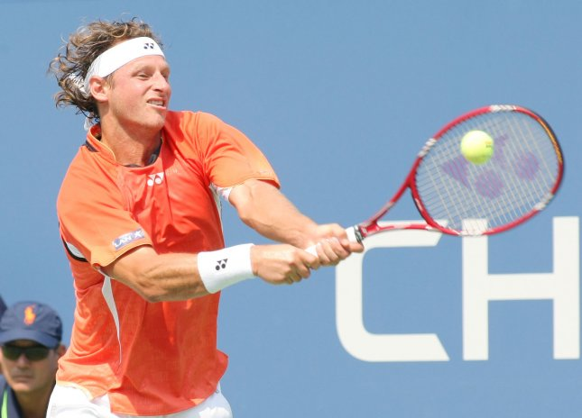 David Nalbandian of Argentina returns the ball to Rafael Nadal of Spain, second seed, during third-round action at the U.S. Open held at the National Tennis Center on September 4, 2011 in New York. UPI/Monika Graff