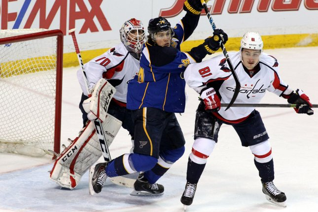 St. Louis Blues T.J. Oshie hooks Washington Capitals Dmitry Orlov in front of the goal in the first period at the Scottrade Center in St. Louis on April 8, 2014. UPI/Rob Cornforth