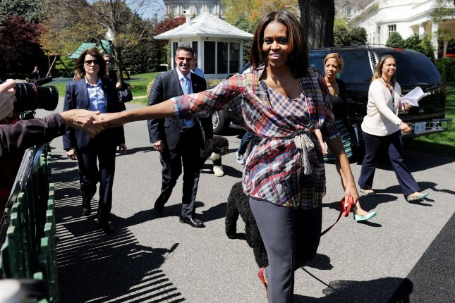 U.S. first lady Michelle Obama cheks hands with guests during the annual White House Easter Egg Roll on the South Lawn of the White House. UPI/Olivier Douliery/Pool