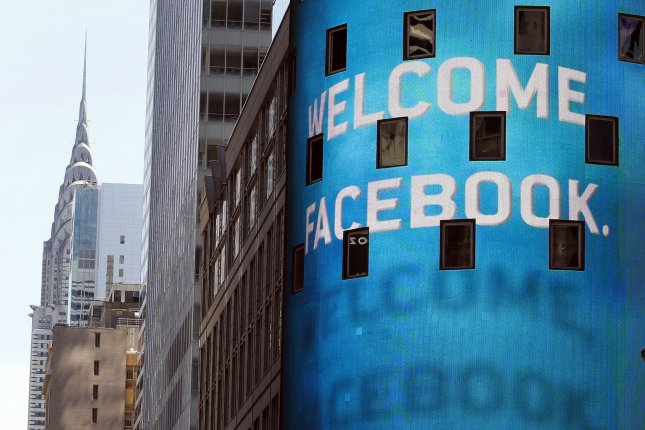 The Chrysler building can be seen in the background with the Nasdaq building in the foreground on the day of the Facebook IPO in Times Square in New York City on May 18, 2012. Facebook is making changes to how photos are saved. File photo by John Angelillo/UPI
