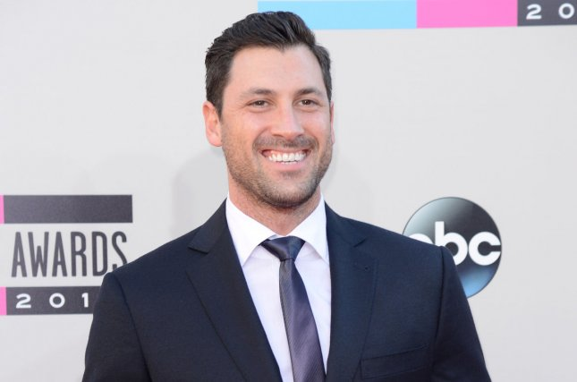 Maksim Chmerkovskiy arrives for the 41st annual American Music Awards on November 24, 2013. Chmerkovskiy revealed on Instagram that he visited fellow Dancing with the Stars alum Mark Ballas in Jersey Boys with fiancee Peta Murgatroyd. File Photo by Phil McCarten/UPI