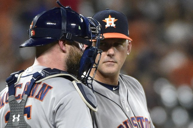 Houston Astros manager A.J. Hinch (R) talks to catcher Brian McCann during a ninth inning pitching change against the Baltimore Orioles at Camden Yards in Baltimore, July 21, 2017. File photo by David Tulis/UPI