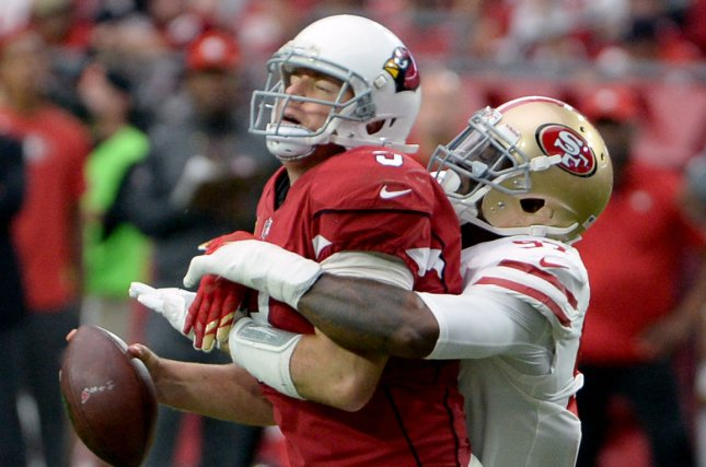 Arizona Cardinals' quarterback Carson Palmer (L) is sacked by San Francisco 49ers' DeForest Buckner in the fourth quarter at University of Phoenix Stadium in Glendale, Arizona, on October 1, 2017. The Cardinals defeated the 49ers 18-15 in overtime. Photo by Art Foxall/UPI