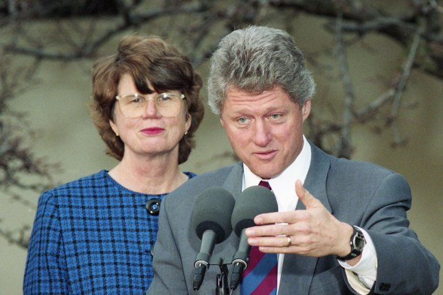 U.S. President Bill Clinton speaks as Janet Reno, the first female nominee for attorney general, listens in the Rose Garden of the White House in Washington on February 11, 1993. On January 12, 1994, Clinton asked Reno to appoint an independent counsel to investigate the Whitewater land deal. UPI File Photo