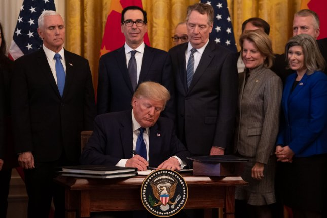 President Donald Trump signs phase one of a trade agreement between the United States and China, at the White House on January 15. File Photo by Kevin Dietsch/UPI