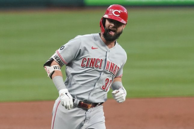 Cincinnati Reds outfielder Jesse Winker runs toward home plate after hitting a two-run home run in the second inning against the St. Louis Cardinals on Thursday at Busch Stadium in St. Louis. Photo by Bill Greenblatt/UPI