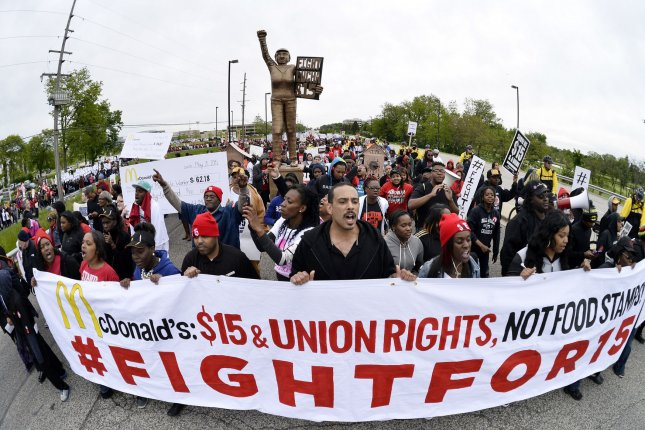 Demonstrators march on McDonald's corporate headquarters demanding a wage increase to $15 per hour on May 20, 2015 in Oak Brook, Illinois. The protest coincides with McDonald's annual shareholder's meeting and comes as the Los Angeles City Council voted Tuesday to raise its minimum wage from the current $9 per hour to $15 per hour by the year 2020. Photo by Brian Kersey/UPI